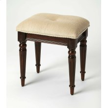 This splendid stool adds formal elegance to any powder or dressing room. Crafted from Poplar solid wood, MDF and Cherry veneer. This stool features impeccable turned and tapered legs, ballerina foot and a comfortable, button tufted, seat upholstered in ch