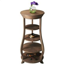 Three adjustable shelves plus top and base provide abundant display possibilities on this elegant etagere. Handcrafted from acacia solid wood in a Toasted Barley finish.