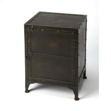 Evocative of a storage locker, this rugged side chest is an inspired addition to any loft space. Forged from iron in a distressed finish, its unembellished design featuring real rivet construction adds industrial flair as chairside or bedside chest. Stora