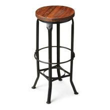 This aged, industrial-look bar stool has a character all its own. Handcrafted from iron and recycled wood solids, it features a distressed finish and a series of circles from base to top and four legs with intriguing bends at top and bottom.