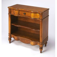 Rich cherry veneers distinguish this traditional bookcase, with carefully crafted curves from rubberwood solids and wood products and a starburst inlay of maple and walnut veneers on the bottom apron. Its inviting Olive Ash Burl finish is the beautiful ba