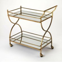 This glamorous modern bart cart is a must-have for anyone that enjoys entertaining. Forged from stainless steel and aluminum, it boasts a mesmerizing antique gold finish with two mirrored glass shelves. Guests will be sure to follow as four large casters