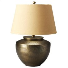 This unique table lamp will brilliantly light any space. Featuring a hammered antique brass finish, it is hand crafted from aluminum with an iron harp and a cotton shade.