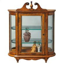 This distinctive wall curio is both functional and beautiful with two adjustable glass shelves and a mirrored back to display your prized possessions. The curved glass sides make it very unique. The glass paneled door features antique brass finished hardw