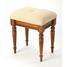 This splendid stool adds formal elegance to any bedroom, walk-in closet or anywhere where extra seating may be needed. Crafted from poplar hardwood solids, wood products and choice cherry veneers, it features a plush button-tufted cotton chenille upholste