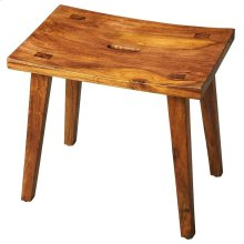 The gently concave seat and zen-like slanted legs of this stool create the irresistible allure of elegant simplicity. The unadulterated wet sand finish showcases the intricate graining of the exotic acacia wood it is crafted from.