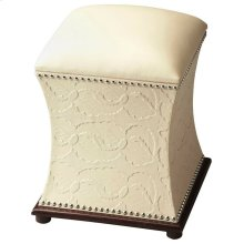 Elegant Bunching Ottoman features hinged top with storage space lined with microfiber, embossed-leather sides with nail-head trim, contrasting dark-wood base and a cream leather top.