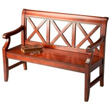 """This alluring transitional bench is a welcome addition to a variety of spaces. Crafted from select hardwoods and wood products, it features bold """"X back supports and a mysterious, lightly distressed Plantation Cherry finish."""