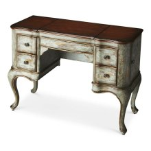 This vanity is every bit as practical as it is beautiful. Crafted from poplar hardwood solids and wood products, it features a Rustic Blue hand painted finish with a heavily distressed cherry veneer top. Side doors open for jewelry storage. Top sides open