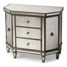 This mirrored console chest is an elegant addition to any foyer, hallway or boudoir. Featuring antique mirror panel inlays and a pewter finish, it is crafted from poplar hardwood solids and wood products. It offers ample storage with three drawers and sid