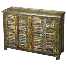 Add a touch of color to your space with the Haveli sideboard. Behind the reclaimed mango wood shutter doors is ample storage to tuck away anything you might need. The heavily distressed painted finish adds interest, texture and a sense of history.