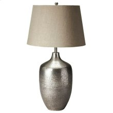 This elegant table lamp will brilliantly light any space. Featuring an antique silver finish, it is hand crafted from aluminum with an iron harp and cotton shade.