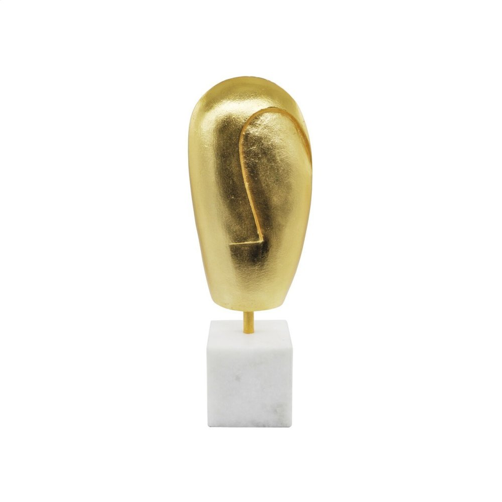 Abstract Face Sculpture On White Marble Stand In Gold Leaf