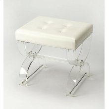 A perfect addition to your powder room or master suite, this chic vanity stool showcases a curved acrylic X frame and a while tufted PVC cushion, a beautifully crafted essential for your space.