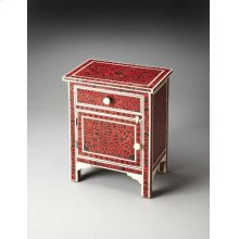 This captivating Chairside Chest, crafted from select solid woods and wood products, features sophisticated artisty and consummate craftsmanship.The botanic patterns covering the piece stem to stern are created from bone inlays dyed black and applied indi